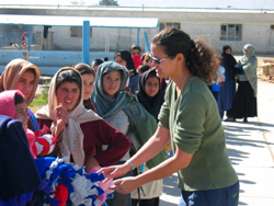 Giving blankets to girls at Allahuddin Orphanage in Afghanistan. Photo c/o thinkbigadventures.com
